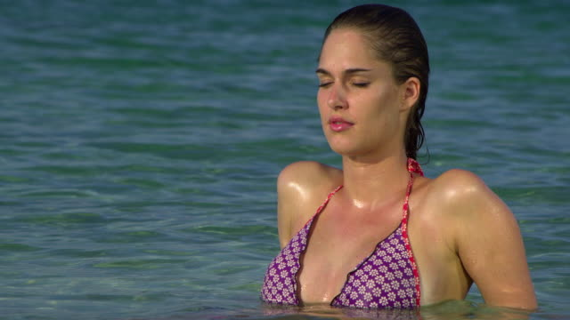 cu young woman relaxing in sea, krabi, thailand - see other clips from this shoot 1459 stock videos and b-roll footage