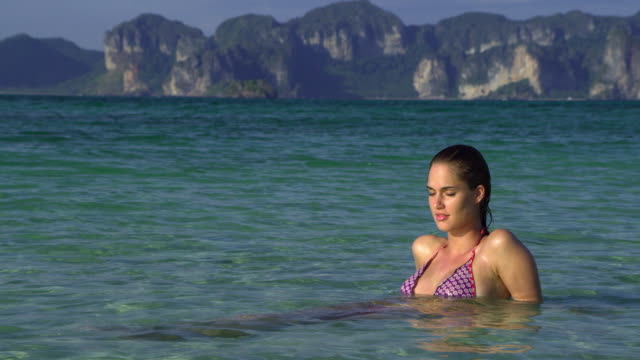ms young woman relaxing in sea, krabi, thailand - see other clips from this shoot 1459 stock videos and b-roll footage