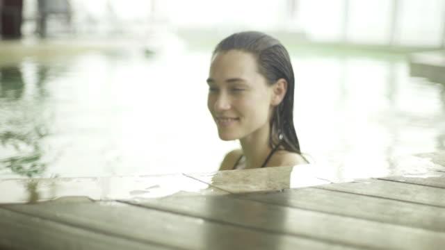 stockvideo's en b-roll-footage met young woman relaxing in spa - binnenbad