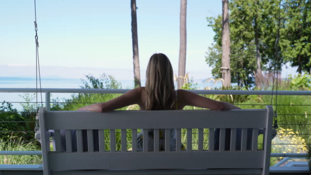 young woman relaxing looking at view