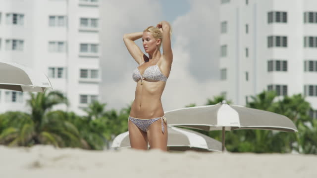 ms young woman relaxing on beach/ south beach, miami, florida, usa - verführerische frau stock-videos und b-roll-filmmaterial