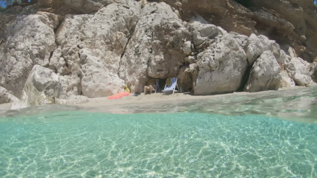 ms young woman relaxing on sunny beach,adriatic sea,croatia - mediterranean sea stock videos & royalty-free footage