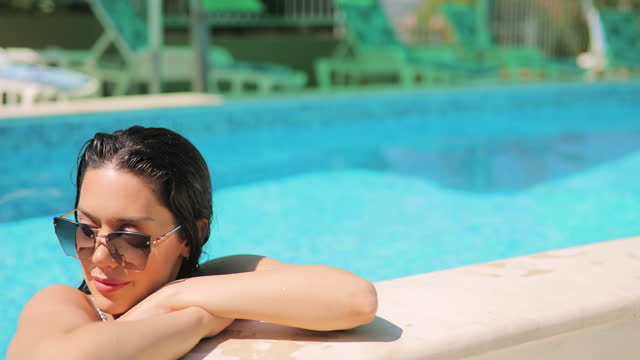 young woman relaxing - sunglasses stock videos & royalty-free footage