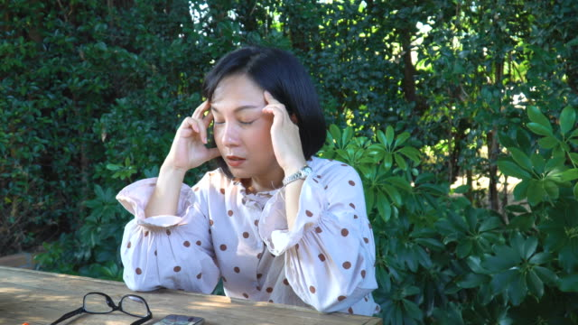 ms young woman remove eye glasses and massage her face - infarction stock videos and b-roll footage