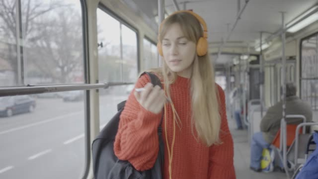 young woman riding in public transportation - bus stock videos & royalty-free footage