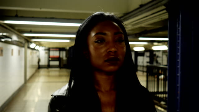 Young Woman Riding the New York City Subway