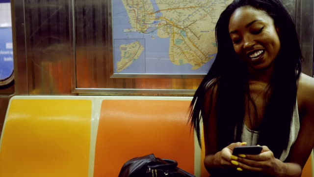 young woman riding the new york city subway - new york city subway stock videos & royalty-free footage