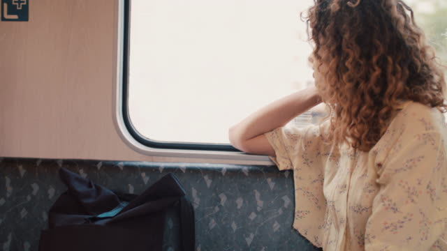 young woman riding train in berlin, germany - passenger stock videos & royalty-free footage
