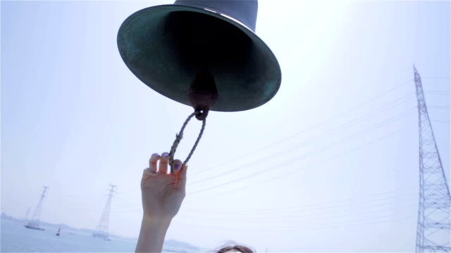 young woman ringing bell on yacht - bell stock videos and b-roll footage