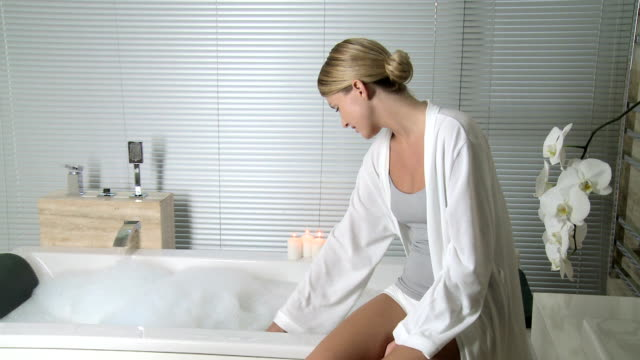 young woman running a bath - serene people stock videos & royalty-free footage