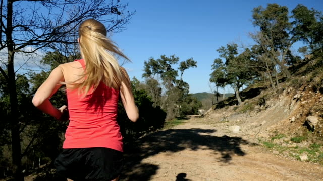young woman running in forest - running shorts stock videos & royalty-free footage