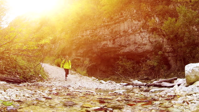 Young woman running in mountain