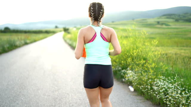 young woman running in nature - self discipline stock videos & royalty-free footage