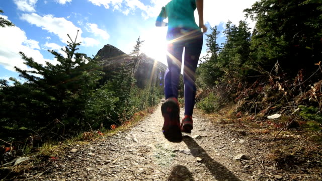 young woman running in nature - banff stock videos & royalty-free footage