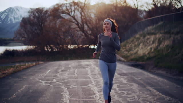 sm ts young woman running in the countryside. - standing water stock videos & royalty-free footage