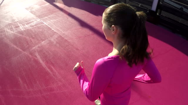 young woman running on a bright pink road - new age stock videos and b-roll footage