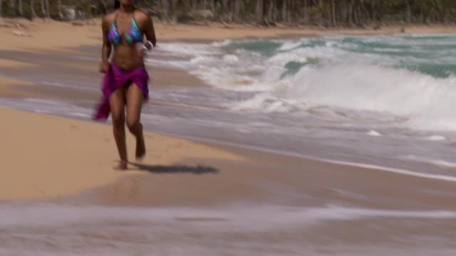 MS, TU, Young woman running on beach, Punta Cana, Dominican Republic