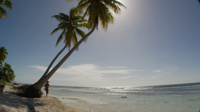 WS, TD, Young woman running on beach, Saona Island, Dominican Republic