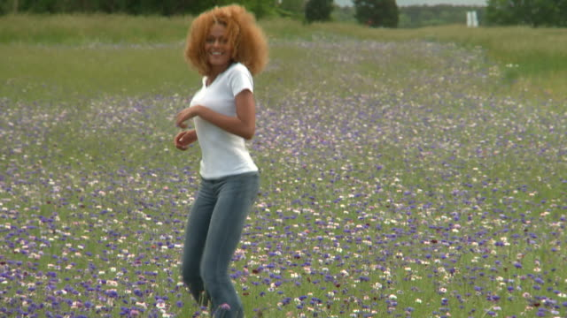 ms young woman running through meadow, eastville, virginia, usa - eastville stock videos and b-roll footage