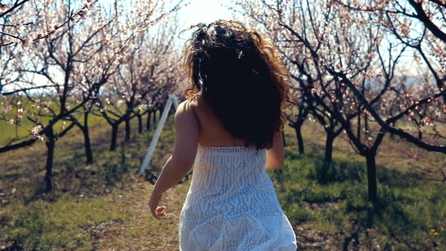 young woman running through the orchard - one teenage girl only stock videos & royalty-free footage