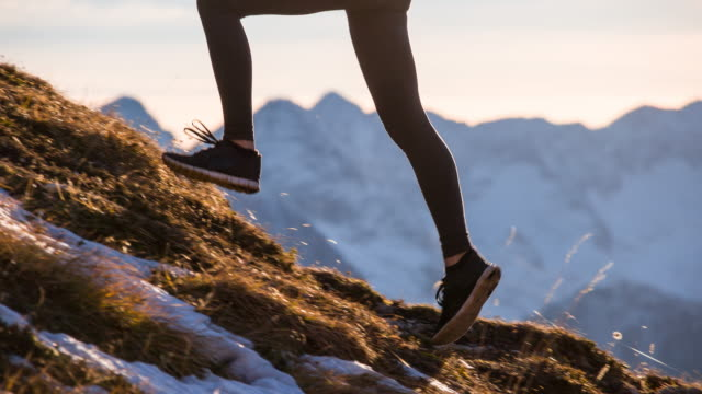 young woman running up the mountain - challenge stock videos & royalty-free footage