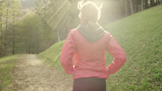 young woman running - jogging stock videos & royalty-free footage