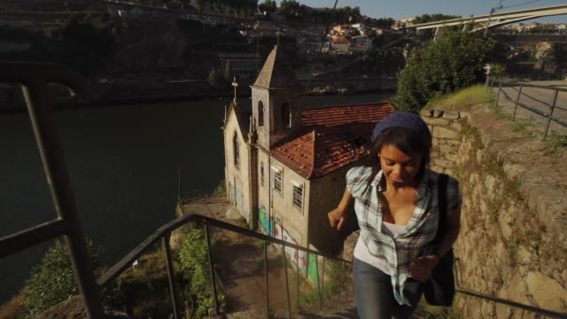 young woman runs near river - porto, portugal - porto district portugal stock videos & royalty-free footage