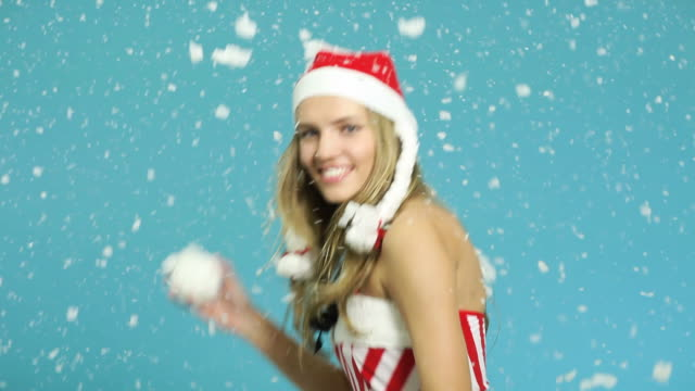 young woman santa helper throwing snowball - santa hat stock videos and b-roll footage