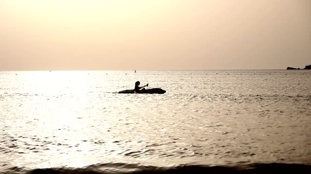 Young Woman Sea Kayaking