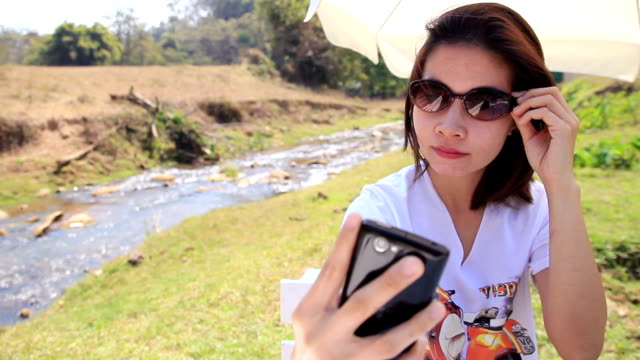 Young woman selfie with smartphone, dolly shot