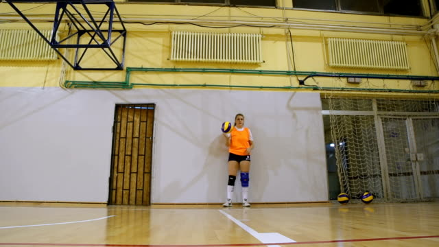 young woman serving in volleyball - serving sport stock videos and b-roll footage