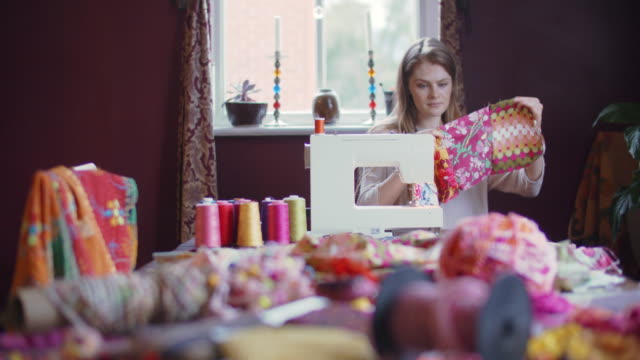 young woman sewing at home - creation stock videos & royalty-free footage