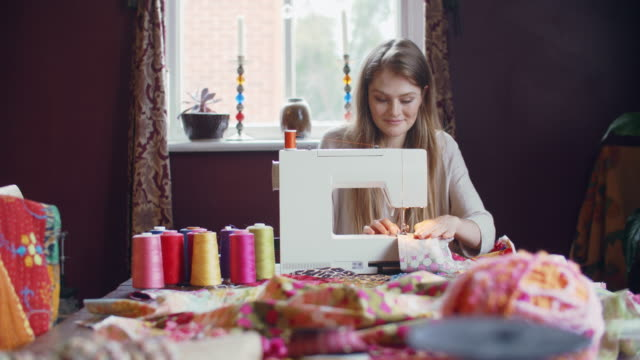 young woman sewing at home - sewing stock videos & royalty-free footage