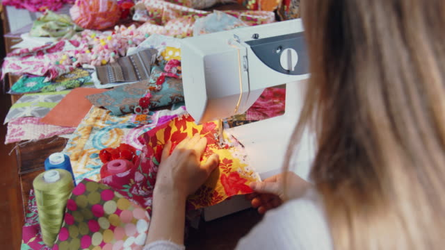 cu rv young woman sewing on her sewing machine - floral pattern stock videos & royalty-free footage