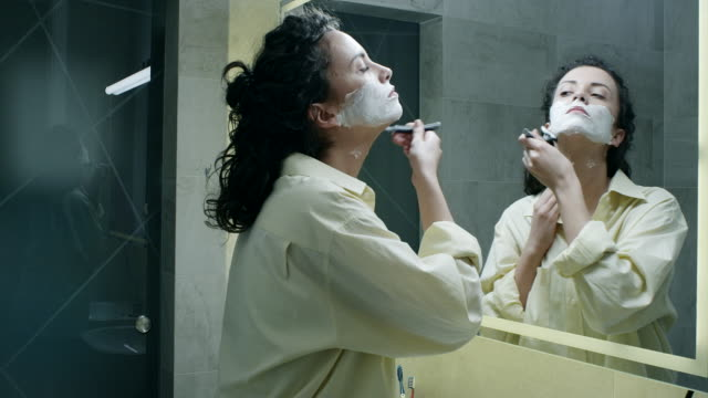 young woman shaving her face - shaving stock videos & royalty-free footage