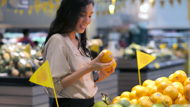 young woman shopping fresh vegetable choose a fruit in market.healthy,lifestyle - choosing stock videos & royalty-free footage