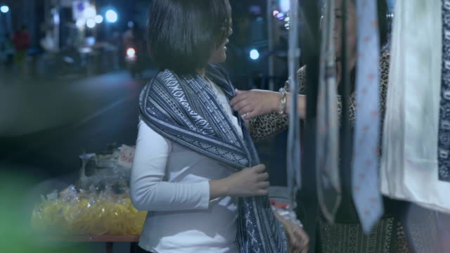 young woman shopping in night market - ethnicity stock videos & royalty-free footage