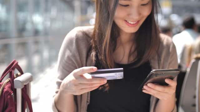 young woman shopping on smart phone with credit card - chinese ethnicity stock videos & royalty-free footage