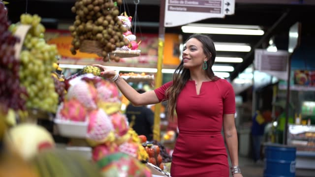 young woman shopping on the local market - south america stock videos & royalty-free footage