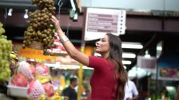 Young woman shopping on the local market