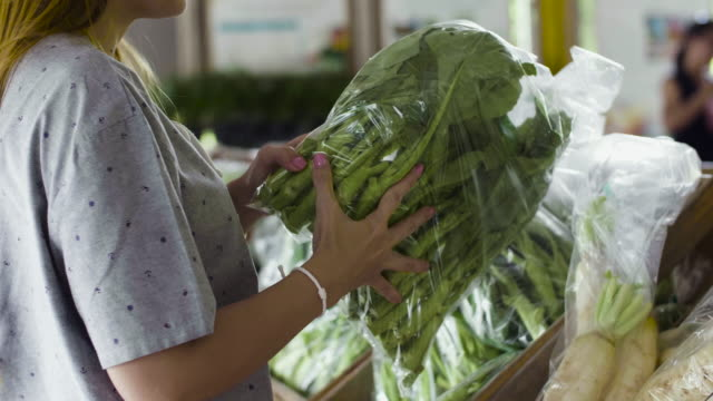 young woman shopping vegetable in fresh market - organic stock videos & royalty-free footage