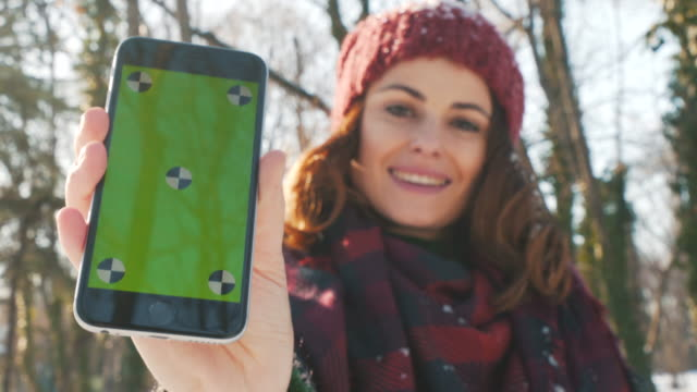 young woman showing phone screen. - millennial generation stock videos & royalty-free footage