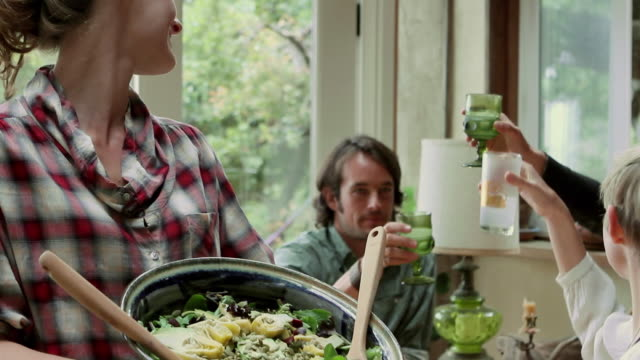 MS PAN TU Young woman showing salad / Big Sur, California, USA