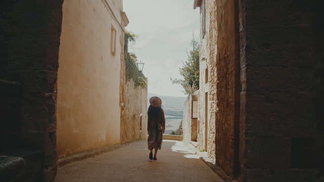 slo mo young woman sightseeing the town pienza - mediterranean culture stock videos & royalty-free footage