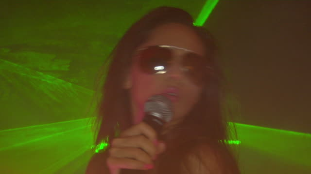 cu, young woman singing and dancing in nightclub, london, england - pop music stock videos & royalty-free footage