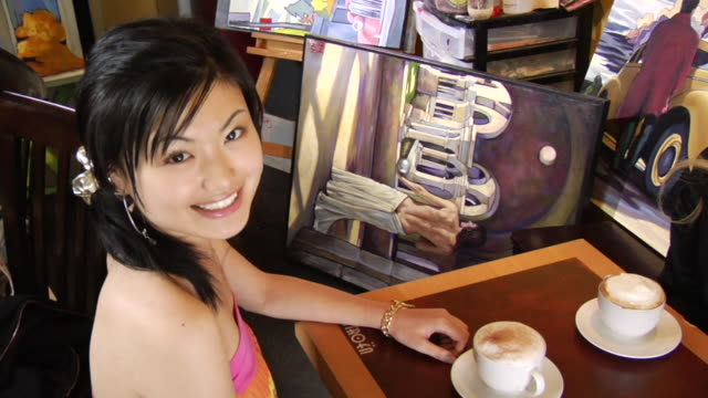 vídeos y material grabado en eventos de stock de ha ms portrait young woman sitting at table in coffee shop with cappuccino/ vancouver, bc - kelly mason videos
