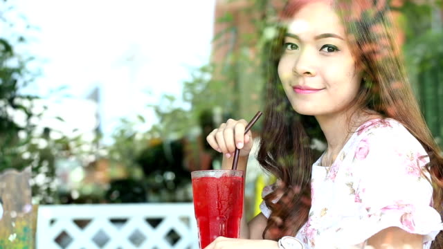 young woman sitting for drink beverages - coffee drink stock videos & royalty-free footage