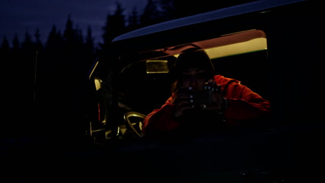 Young woman sitting in the car. Night ride