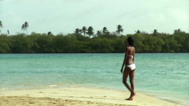 ws young woman sitting on beach / scarborough, tobago, trinidad and tobago - trinidad trinidad and tobago stock videos & royalty-free footage