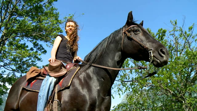 hd: young woman sitting on horse - hoofed mammal stock videos & royalty-free footage
